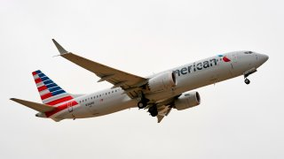 An American Airlines Boeing 737 MAX airplane takes off on a test flight from Dallas-Fort Worth International Airport in Dallas, Texas, on December 2, 2020. - The Boeing 737 MAX is taking another key step in its comeback to commercial travel by attempting to reassure the public with a test flight by American Airlines conducted for the news media.