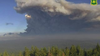 plumes of smoke rise from the Caldor Fire in El Dorado County, Calif.